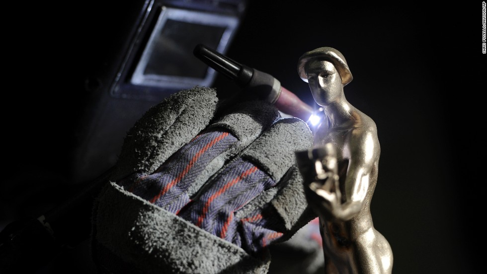 A worker welds one of the statuettes. The SAG Awards honor television and film actors, and winners are chosen by their acting peers.