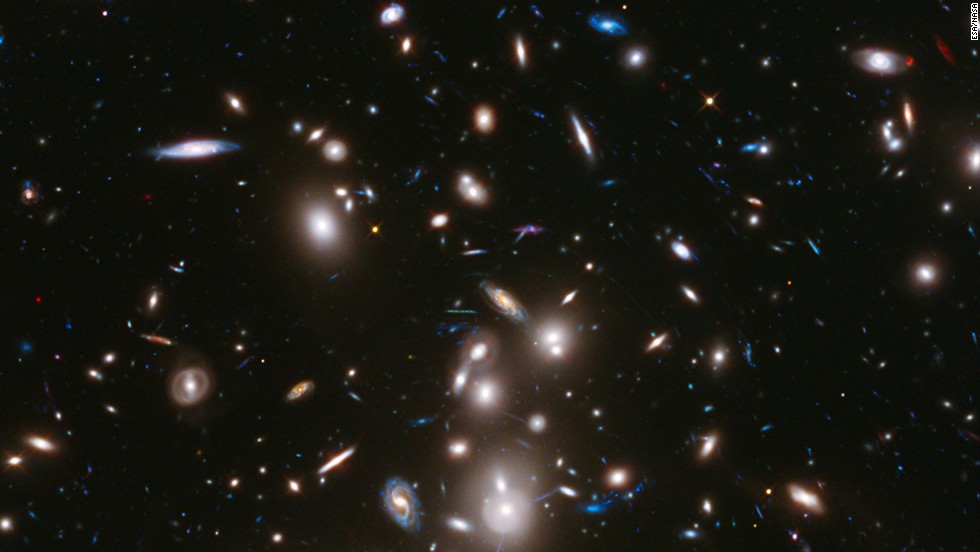 "This long-exposure image from the Hubble Telescope is the <a href=""http://hubblesite.org/newscenter/archive/releases/2014/01/full/"" target=""_blank"">deepest-ever picture taken of a cluster of galaxies. The cluster, </a>called Abell 2744, contains several hundred galaxies as they looked 3.5 billion years ago; the more distant galaxies appear as they did more than 12 billion years ago, not long after the Big Bang."