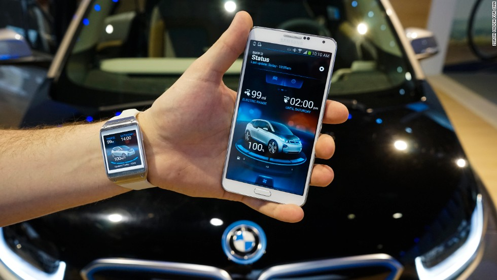 Samsung shows off the Galaxy Gear smart watch and Galaxy phone running the BMWi Remote App which allows you to connect to an equipped BMW car.