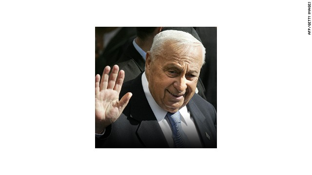 Israeli Prime Minister Ariel Sharon waves to the audience as he arrives to participate in a memorial ceremony for Israel's first Prime Minister David Ben Gurion marking the 32nd anniversary for his death, in Sde Boker in the Negev desert southern of Israel 07 December 2005.