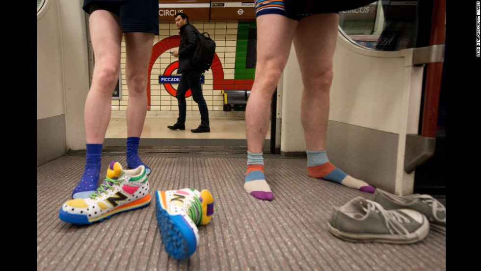"Participants in the 13th ""No Pants Subway Ride"" travel on an Underground train in London on Sunday, January 12. The annual event first <a href=""http://improveverywhere.com/missions/the-no-pants-subway-ride/"" target=""_blank"">started in New York City</a> in 2002, when one pantsless participant boarded a subway at each of seven consecutive stops, claiming to have forgotten his pants. Since then, cities all over the world have seen bare-legged patrons on subways."