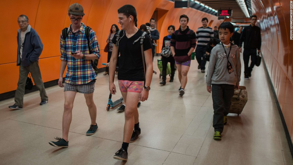 People walk around a Hong Kong train station in their underwear.
