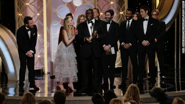 "Director Steve McQueen and cast accept the best motion picture award for the drama ""12 Years a Slave"" at the Golden Globes."