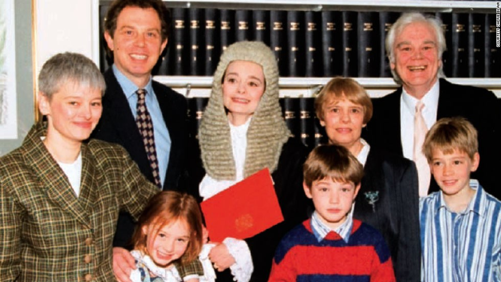 "As her spouse rose in the political ranks, Blair -- who professionally goes by her maiden name of ""Cherie Booth"" -- carved out a successful career first as an attorney, then in 1995 (pictured here with her family) she received the senior advocate status of Queen's Counsel."