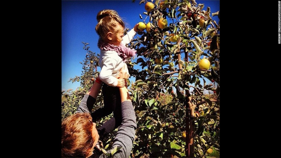 "<strong>#FallisHere winner —</strong> ""We love the colors, the fall activity of apple picking, and how can you not fall in love with this little girl?!"" wrote ""New Day"" co-host Kate Bolduan in the first of her 2013 Instagram challenges. The winning photo came from <a href=""http://instagram.com/p/fIj6QgrfnQ/"" target=""_blank"">@ambergoley</a>."