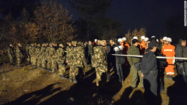 Chinese rescuers guard a closed area after an explosion in southwest China's Guizhou province, on January 13.