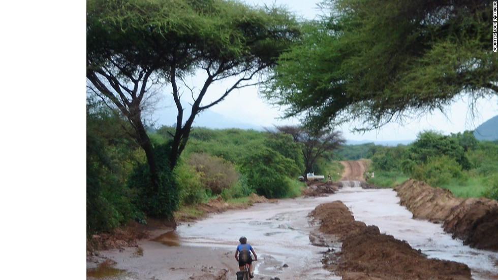 Desert heat isn't the only climatic challenge. Roads become mud baths during Tanzania's rainy season.(Pictured, 2013 Tour)
