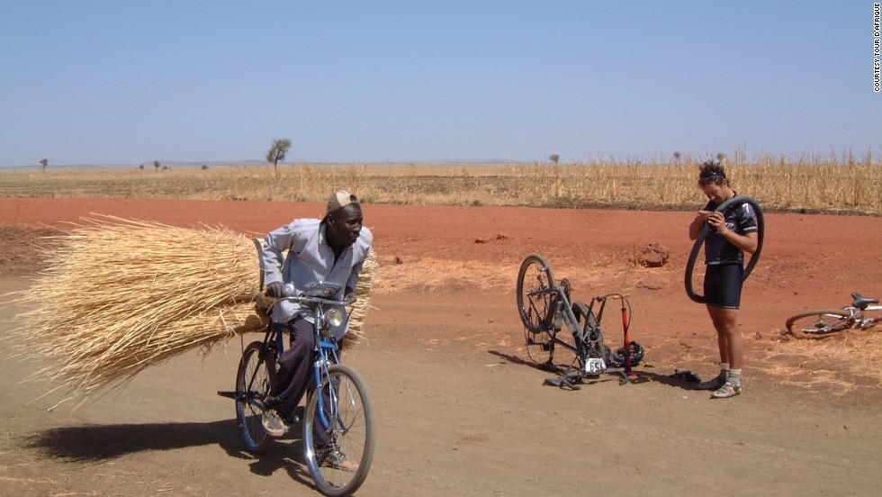 This local cyclist performs an endurance feat of his own, while a competitor deals with a puncture. (Pictured, 2013 Tour)