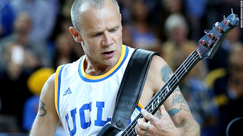 Legendary rock bassist Flea, here performing the U.S. national anthem before a college basketball game between the Arizona Wildcats and the UCLA Bruins, will play at this year's Super Bowl with his band the Red Hot Chili Peppers.