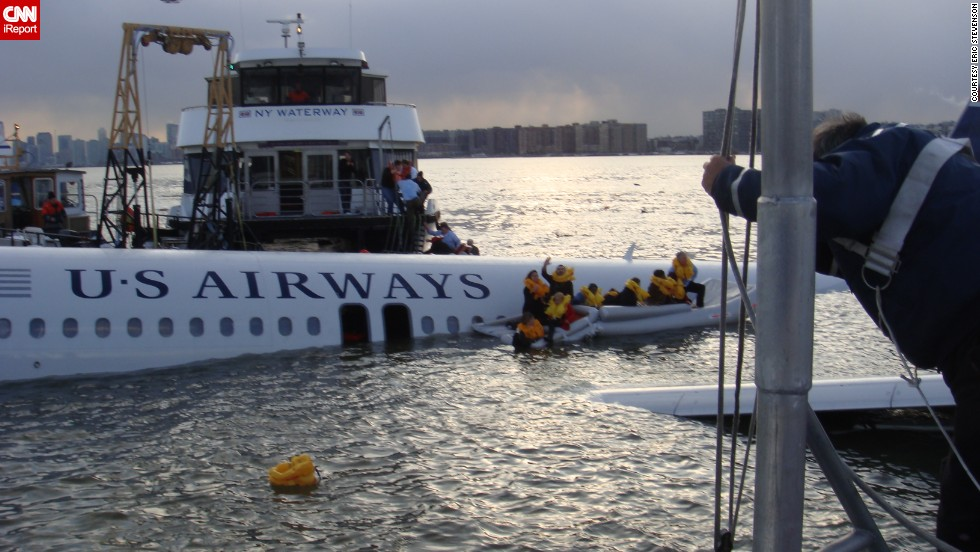"<a href=""http://ireport.cnn.com/docs/DOC-183399"">Eric Stevenson</a> was a passenger on flight 1549, seated over the wing in 12F. He took this photo just after boarding the rescue boat."