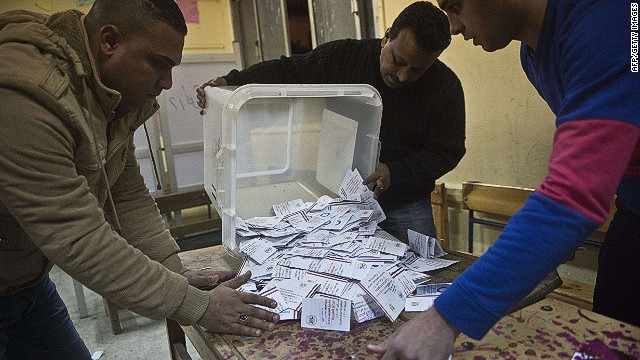 Officials in Cairo earlier this week count ballots from the constitutional referendum.