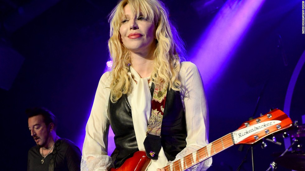 Courtney Love, the former singer and guitarist for alternative rock band Hole, remains a symbol of the 90s grunge music scene and excess. Married to Nirvana's Kurt Cobain until his suicide in 1994, Love has been locked in legal disputes with other former Nirvana members. Love, who was born on July 9, 1964, continues to create music and court controversy. Her memoir is expected to be published this year.