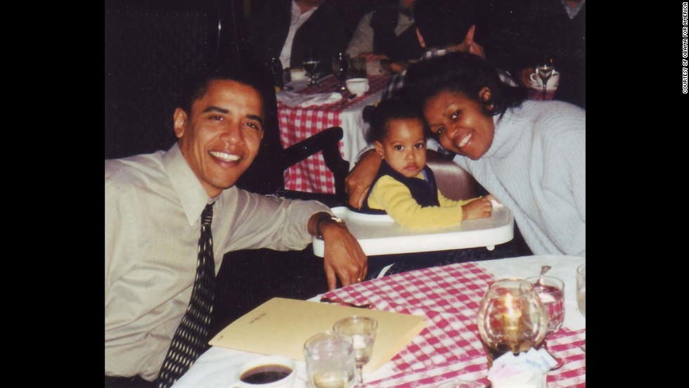 The Obamas have dinner in 2000 with their first child, Malia. Malia was born on July 4, 1998.
