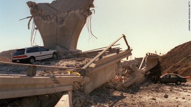 Cars lie smashed by the collapsed Interstate 5 connector few hours after Northridge earthquake, on January 17, 1994, in Sylmar, California.