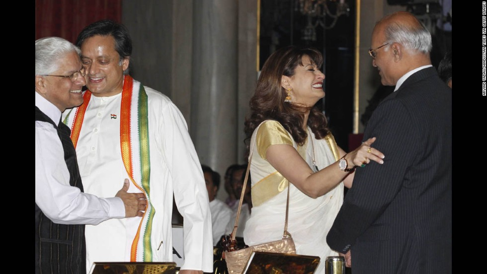 Tharoor and his wife, with Ashwani Kumar, left, and Shiv Shankar Menon, attend a swearing-in ceremony for new ministers at Rashtrapati Bhavan, the Indian President's home, on October 28, 2012, in New Delhi. The couple was active in New Delhi's glamorous social circles.<br />