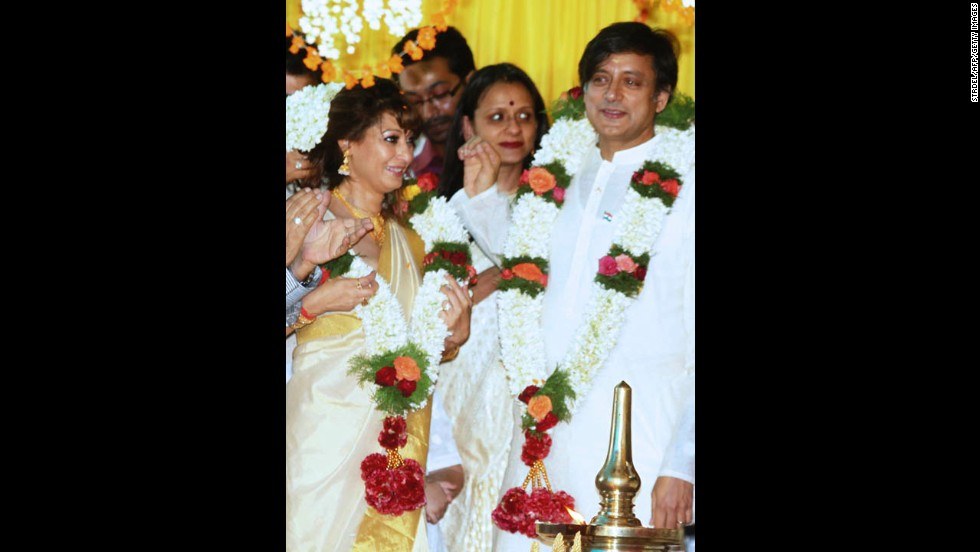 Tharoor, right, and his bride, left, take part in their wedding ceremony in the town of Palakad, India, on August 22, 2010.