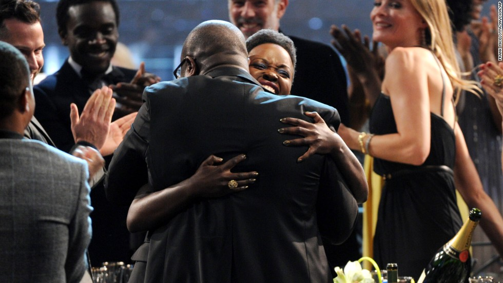 Nyong'o embraces director Steve McQueen after winning her award.