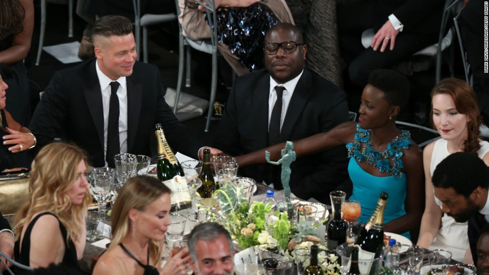 From left, Brad Pitt, Steve McQueen and Lupita Nyong'o at their table during the show.