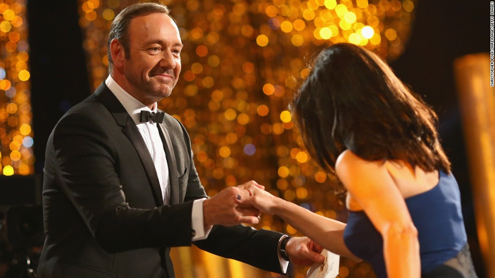 "Kevin Spacey helps Julia Louis-Dreyfus onstage. She won best female actor in a comedy series for ""Veep."""