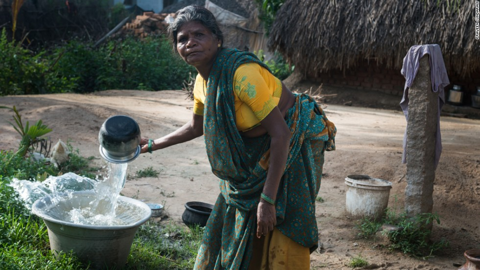 "A woman in Vilupuram, India, washes pots and pans at her new water point. With safe water at her home, she no longer has to make daily trips to the river. Matt Damon and Gary White co-founded <a href=""http://water.org/"" target=""_blank"">Water.org</a>, a nonprofit that helps communities achieve sustainable water systems. Click through to see the work they are doing throughout the world:"