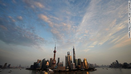 View of the Pudong financial district skyline from the historic Bund in Shanghai on October 29, 2013. China's ruling Communist Party will hold a key four-day gathering early next month, that could serve as the venue for the announcement of far-reaching economic reforms. The Communist Party's third plenum traditionally sets the economic tone for the Chinese government's next five-year term. AFP PHOTO/Mark RALSTON (Photo credit should read MARK RALSTON/AFP/Getty Images)