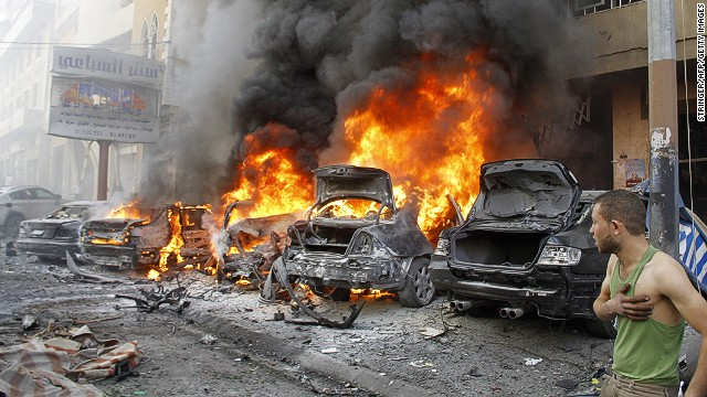 Cars burn after an explosion in Haret Hreik in southern Beirut on Tuesday.