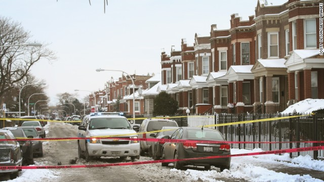Police investigate a murder of a 68-year-old man in the Logan Square neighborhood of Chicago on December 15, 2013.