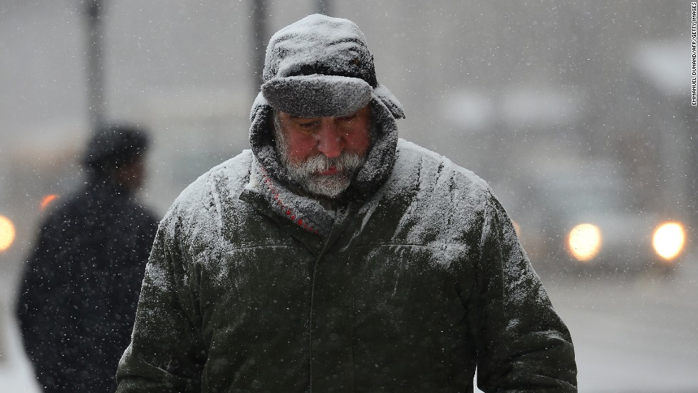 A man walks through a snow storm in New York on January 21, as a storm alert was issued from noon Tuesday until 6 a.m. Wednesday, with as much as a foot of snow forecast for the metro area.