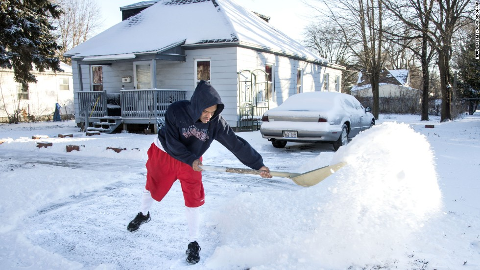 Antione Larkins shovels snow out of his driveway in Champaign, Illinois, on January 21.