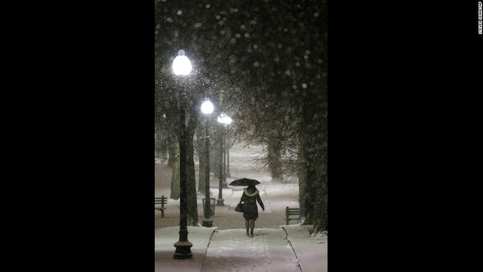An umbrella comes in handy for a woman on a snow-covered path in Boston Common on January 21.