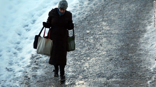 NEW YORK, NY - JANUARY 22:  A woman heads into a subway stop in Brooklyn on the morning after a major winter storm blanketed much of New York City in 10 to 12 inches of snow on January 22, 2014 in New York City. While the storm caused major traffic and subway delays, New York City area schools were open on Wednesday morning.  (Photo by Spencer Platt/Getty Images)