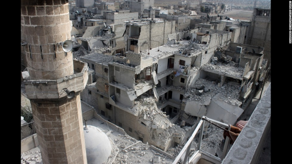 Buildings lie in ruins in Aleppo on Sunday, January 19, after reported air raids by Syrian government planes.