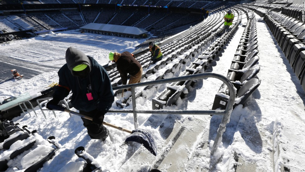 Workers shovel snow off seating at MetLife Stadium in East Rutherford, New Jersey, on January 22. The stadium will host Super Bowl XLVIII.