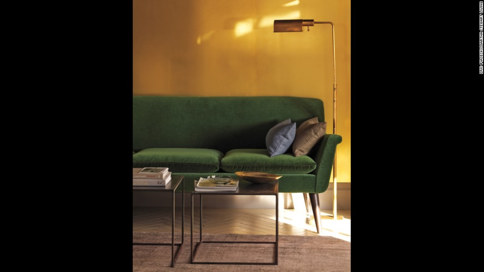 Go bold. A wall clad in sheets of unlacquered, untreated brass laminate adds high drama to a living room. A complement to the forest green sofa and brass accents in this room, the partition will develop a rich patina over time. To achieve a similar effect on a smaller scale, try applying the sheeting to the back of a bookshelf or wet bar.