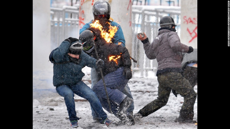 Flames leap off a protester during clashes with police on January 22.