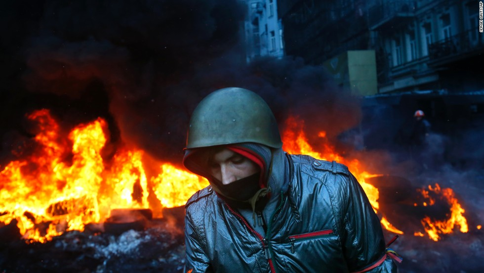 A protester walks past burning tires in Kiev on January 23.