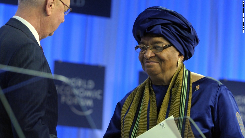 WEF Executive Chairman Klaus Schwab shakes hands with Liberia's President Ellen Johnson-Sirleaf.