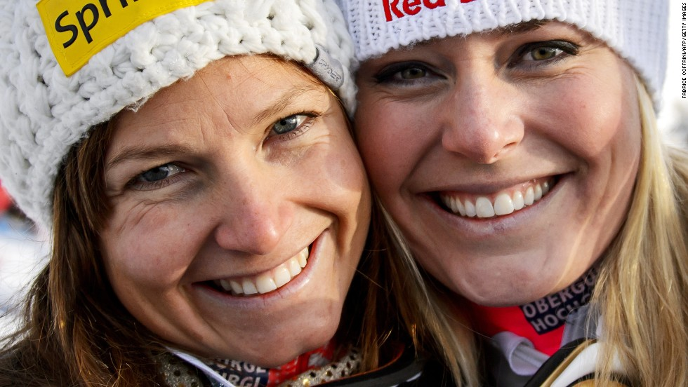 Normally U.S. teammates, Julia Mancuso (left) will be the one going for gold in Sochi while the injured Lindsey Vonn (right) will watch at home as a TV correspondent.