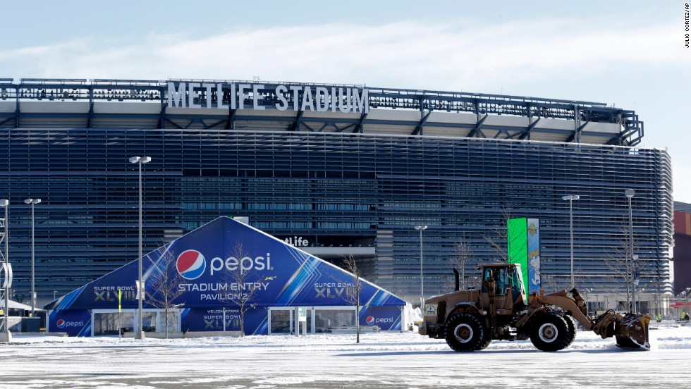A tractor plows snow at MetLife Stadium on Wednesday, January 22.