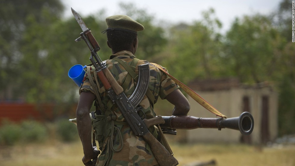 A South Sudanese People's Liberation Army soldier patrols in Malakal on Tuesday, January 21.