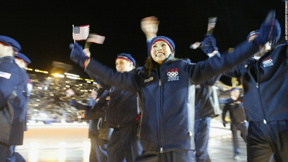 U.S. athletes at the 2002 Winter Olympics in Salt Lake City, Utah. Here, figure skater Michelle Kwan waves to the crowd at the opening ceremony