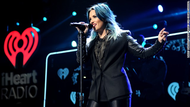 SUNRISE, FL - DECEMBER 20:  Demi Lovato performs onstage during Y100's Jingle Ball 2013 Presented by Jam Audio Collection at BB&T Center on December 20, 2013 in Miami, Florida.  (Photo by Larry Marano/Getty Images for Clear Channel)