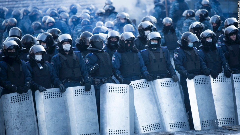 Riot police stand guard near Dynamo Stadium on January 24.