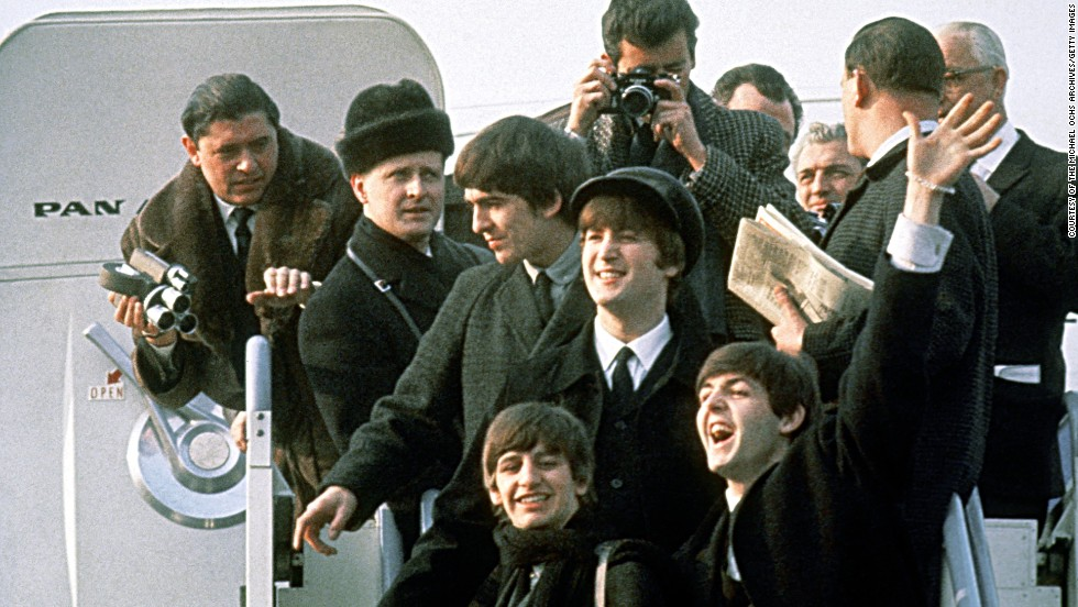 "The Beatles arrive in New York on February 7, 1964. The band from Liverpool, England, already had the No. 1 U.S. single, ""I Want to Hold Your Hand,"" but its U.S. visit confirmed that ""Beatlemania"" had made its way across the pond."