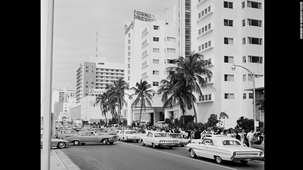"Lines form down the street from the Deauville Hotel in Miami Beach, Florida, as fans wait to see The Beatles on ""The Ed Sullivan Show"" on February 16, 1964. It was a week after the band's first appearance on the show."