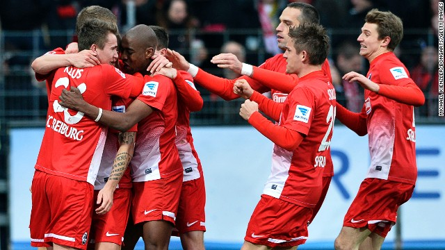 Freiburg's players celebrate scored their second goal against Leverkusen on Saturday.