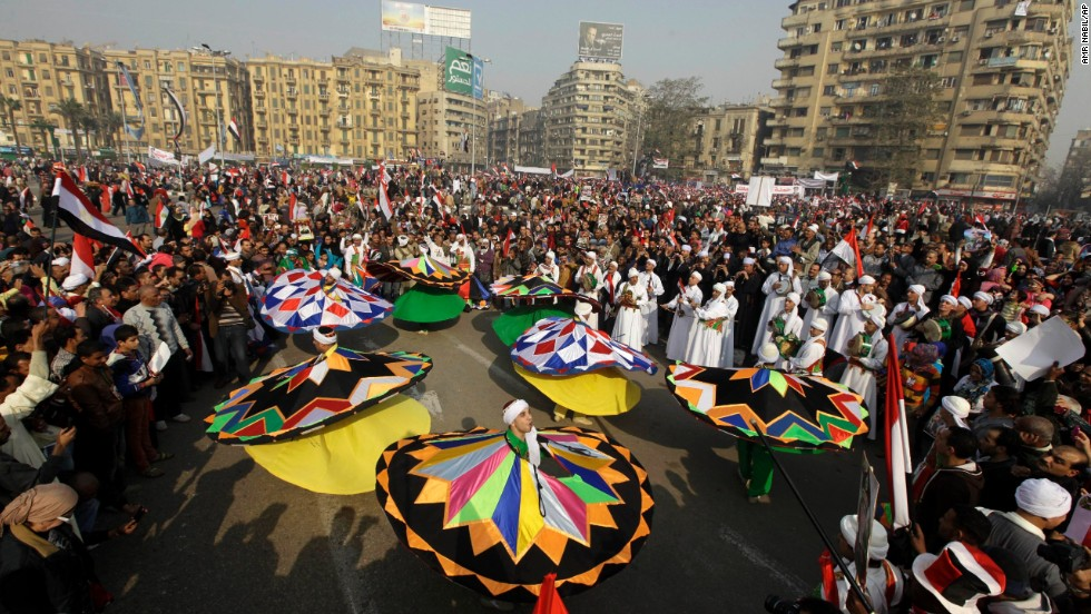 Egyptian traditional dancers perform at a pro-military rally in Tahrir Square.