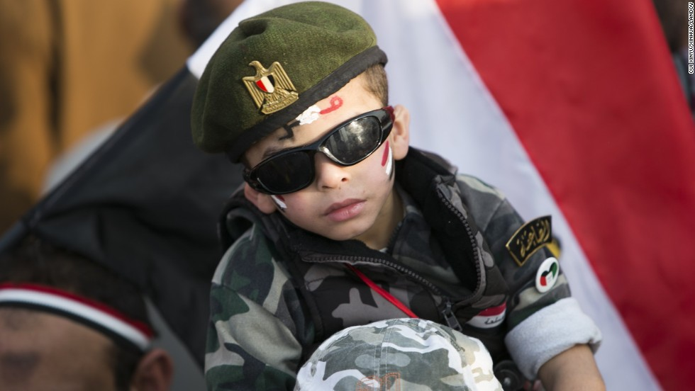 A boy is seen during a rally marking the anniversary.