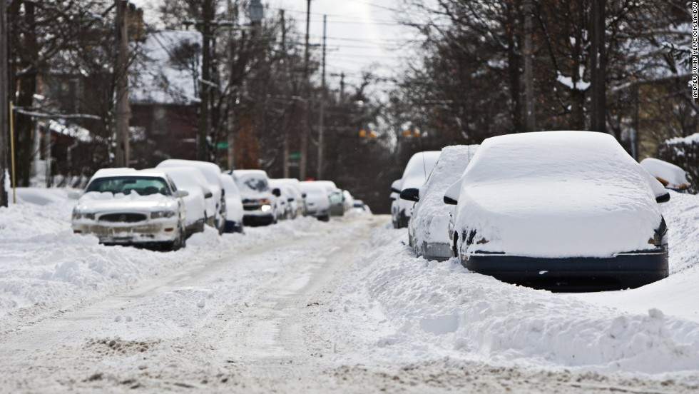 Cars sit in drifts and plowed snow on January 25 in Grand Rapids, Michigan.
