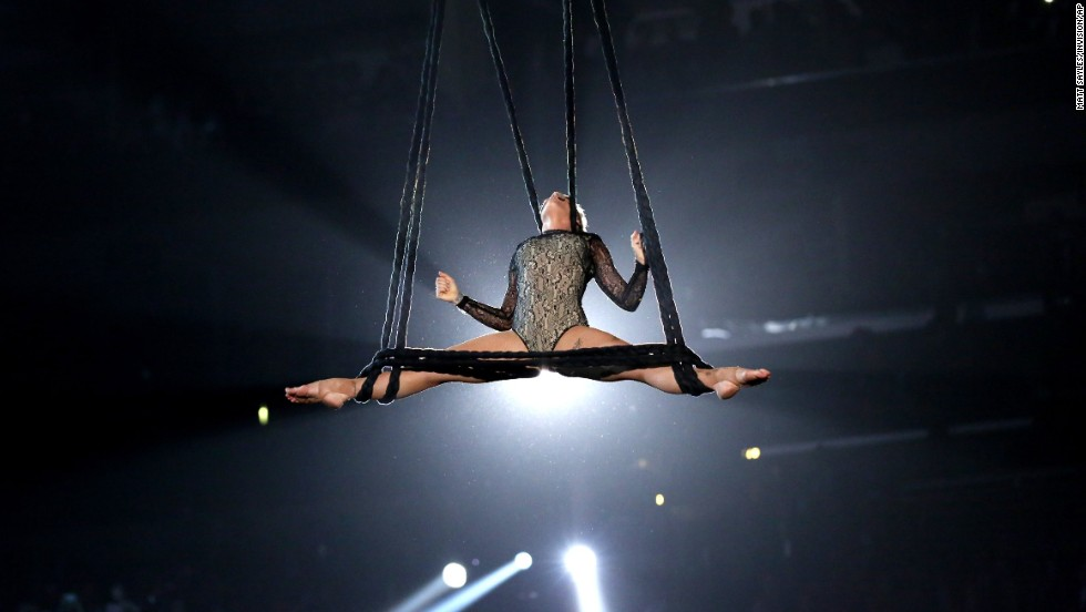 "Pink shows off her aerial acrobatics while performing ""Just Give Me a Reason."" She opened her set with the song ""Try."""